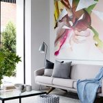 adorable wall painting idea with gray sofa design and glass coffee table and gray area rug and glass window