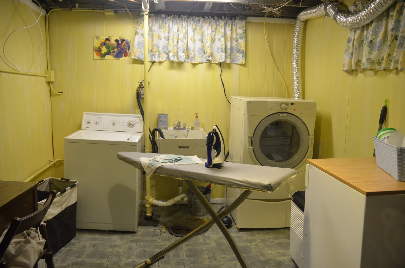 Adorable Yellow Basement Laundry Design With Ironing Board And Wooden  Storage And Sleeve For Window And