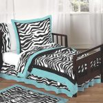 adorable zebra patterned bedding design with turquoise accent on black wooden frame on wodoen floor in white room