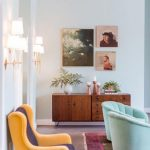 amazing interior decoration with yellow sofa and blue couch and pink area rug and wooden console table and wall pictures