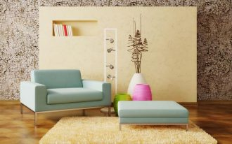 amazing interior design with tan panel board and retro wallpaper and soft belu couch with blue coffee table and pink green white pottery and creamy area rug