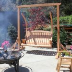 amazing porch swing set design made of wooden material on concrete patio with firepit and seating
