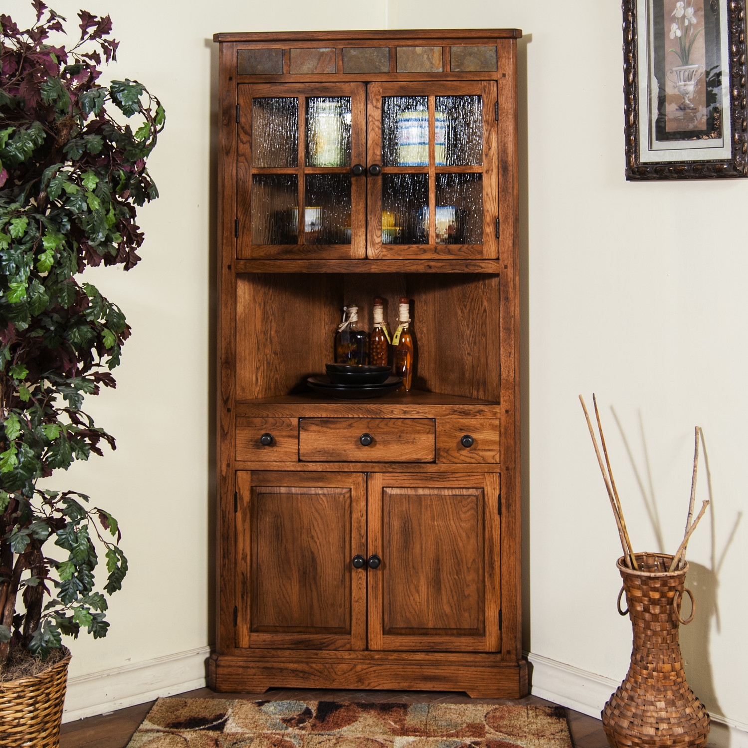 amazing rustic tall china corner  cabinet with glass doors and a drawer and two wooden doors decorated with unique rug and potted plant
