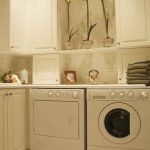 awesome beige basement laundry room idea with floating wall cabinet adn compact washing and drying machine with diamond shaped tile flooring
