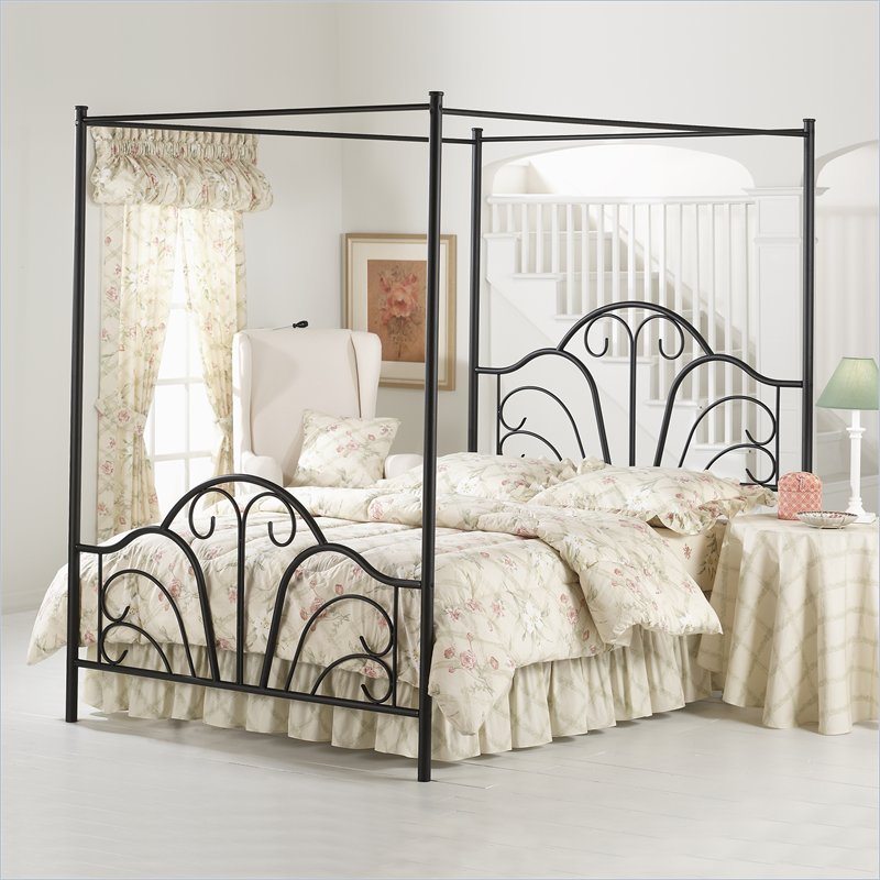 beautiful iron canopy bed frame with girly bedding set plus comfy white chairs plus round night