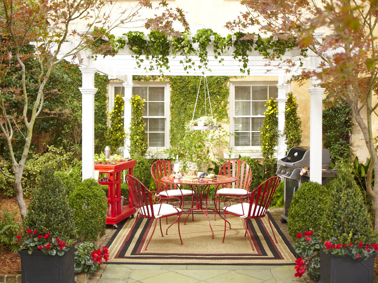 Beautiful Outdoor Patio With Red Seating Design With White Pergola With  Clematis With Area Rug And