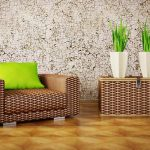 beautiful vintage interior design with retro wallpaper with brown rattan sofa and rattan table with green cushion and indoor plants and wooden floor