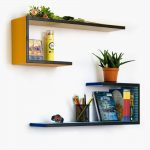 best creative shelving idea with black orange and black blue combination with indoor plant decoration and s shape on the wall