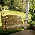 best natural porch swing set idea with wooden material and chain suspension aside a wide garden with green grassy meadow