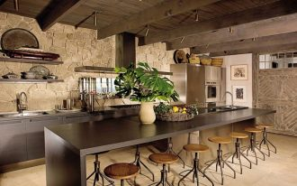 best rustic kitchen design idea with long bar table with round woodne stools idea with potted plant and exposed wooen beams and wooden looringa nd stone siding
