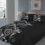 black cool comforter sets in bedroom plus grey wall paint color and wooden bed frame plus white table lamp