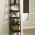 black wooden modern ladder bookshelve design with bamboo storage on wooden floor and red pottery