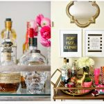 breathtaking bar cart accessories with wine and liquors plus cutest flowers on the vase and straws plus decorative poster on the wall and mirror
