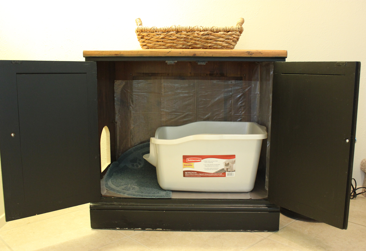 cat litter box ideas with black wooden cabinets with 2 doors and cute fruit basket on