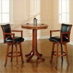 classic round pub tables and black leather upholstery stools completed with back and arm plus gorgeous wooden floor