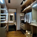 classy and serene dressing room design idea with modern wardrobe storage with lighting and wooden floor