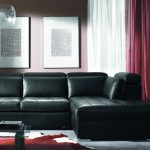 classy black leather ikea sofa bed idea with red and white curtain and red indoor plant and white black storage detail