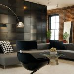 classy blacl bachelor pad furniture idea with black tile siding decoration with gray couch idea and round glass coffee table with black egg chair and red brick wall and glass window