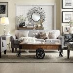 classy oxford creek furniture for beautiful living room ideas combined with cozy couch and grey arm chair and round mirror on brick wall plus jute rug and classic coffee table with wheel