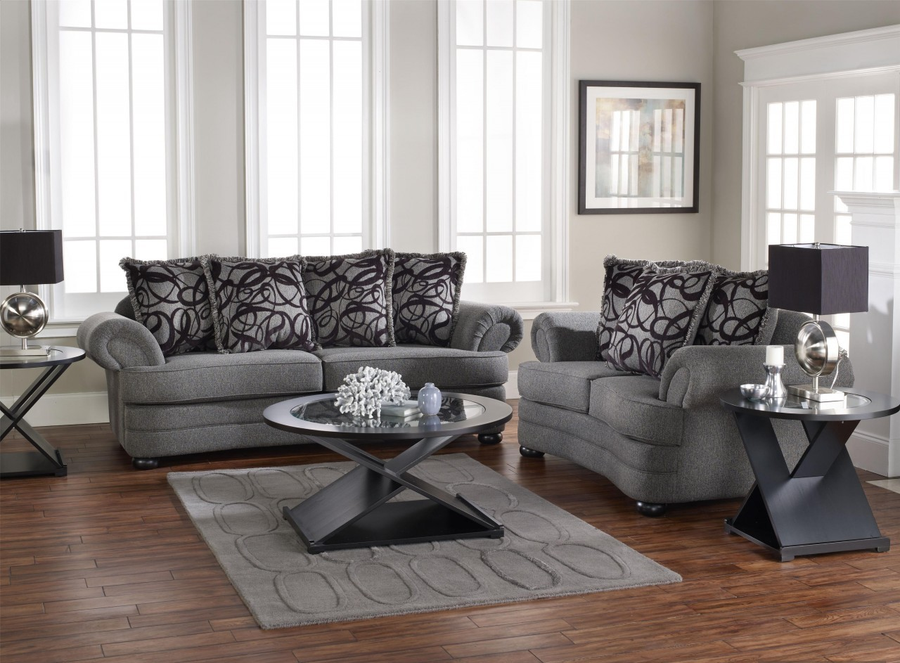Living room design with gray sofa displays comfort and for Living room sofa table decorating