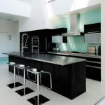 contemporary black and white kitchen idea decor with black appliances and modern stools and white flooring and ceiling
