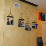 cool hanging bookshelves with jute rope and single slot on creamy panel boards with pictures