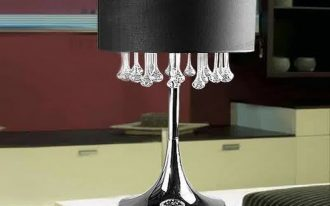 cordless table lamp with stainless steel base and black cap plus crystal decoration