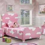 cow print pink furniture in the bedroom wit pink bedding nighstand and table and wallpaper and area rug