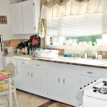creative kitchen makeovers on a budget with white cabinets and pretty window treatment with white shades and brown valances and small dining spaces