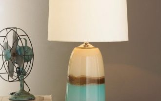 cute turquoise and cream 3 way table lamps with unique pudding lamp post and white shades decorated on wooden table and table fan