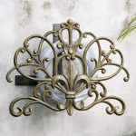 decorative-fleur-de-lis-garden-hose-holder-from-fleur-collection-with-alumiinum-and-iron-construction-with-gold-color-and-metal-material-also-mounted-oon-the-white-wall
