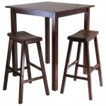 effortless pub tables and two stools made of wooden in brown finish for home decoration