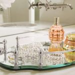 eleagnt single storey vanity drseer tray set with etal handles for parfume storage beneath wall mirror with orchid decoration