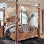 elegant arched cherry wood headboard idea with canopy and bold beams and black area rug and gray bedding and arched glass window