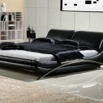 elegant modern king size bed frame with black leather and steel frame featuring modern nightstand plus classy bookshelf