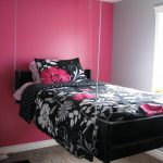 elegant retro best rated air mattress idea with black white pin floral patterned sheet on black platform in pink bedroom