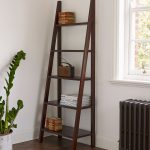 exotic brown furnished woodern modern ladder bookshelf idea with four legs in white room with glass window and indoor plant and wooden floor