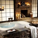 exotic posh bathroom design with spa and candelabrum and fireplace and bar frosted glass window and rustic flooring idea and natural stone