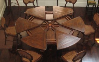 expandable-round-dining-table-with-great-quality-with-six-wooden-chairs-on-the-wooden-floor
