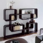 fancy-and-modern-decorative-shelving-unit-with-dark-brown-varnished-wood-bookshelf-wall-near-white-fur-rug-for-small-living-room-spaces