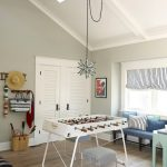fun game room ideas with moravian star pendant light fixture and blue bench and cozy stool plus wooden laminating floor and wooden wall