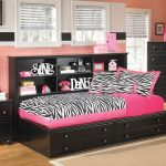 girly black daybeds with storage with pink zebra bedding linen and headboard with shelves together with wooden nightstand with table lamp and dresser and light brown rug