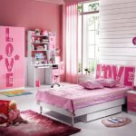 girly pink bedroom design with pink furniture bedding and closet and desk and area rug and white siding and glass window