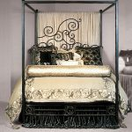 glamour iron canopy bed frame with golden comforter set plus sweet curtain and elegant pillows plus night table in silver