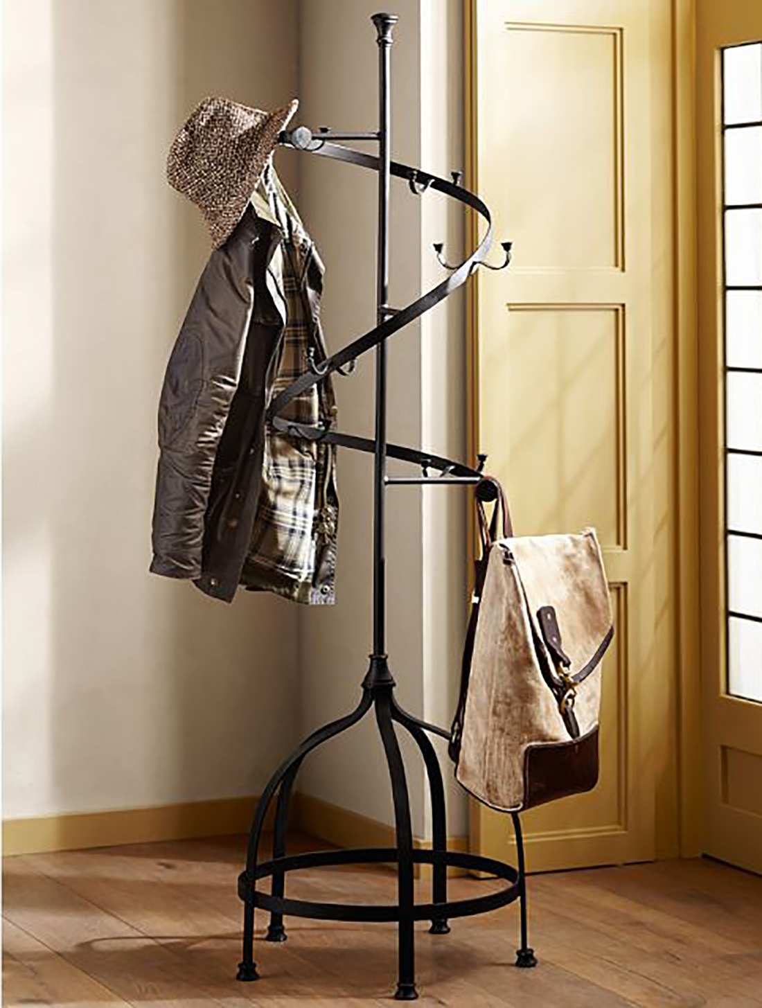 High Quality Gorgeous Black Metal Spiral Coat Rack Ideas With Wooden Floor With Bag  Hooks And Hats Aside