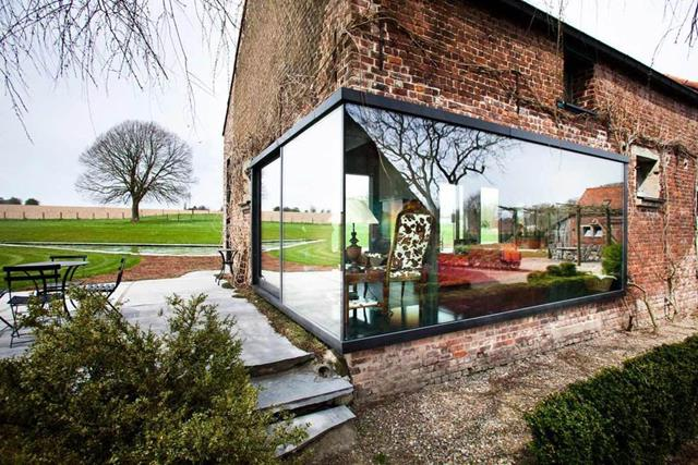 gorgeous brick wall small farm house design with super bright open concept and extended outdoor living space with minimal garden