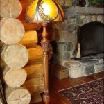 gorgeous classic custom lamp shade idea with carved stand in log house with stone fireplace and morroccan area rug