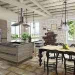 gorgeous gray white rustic kicthen design with dining table with black chairs and brick wall and gray cabinet island and lighting