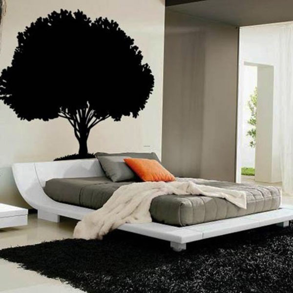gorgeous modern bedroom design with tree wall decoration with sophisticated white bedding and gray mattress and orange pillow and black sheepskin ikea rug
