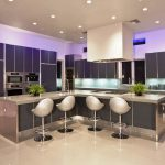 gorgeous modern kitchen design with gray cabinetry and modern stools and purple fluorescent lighting idea